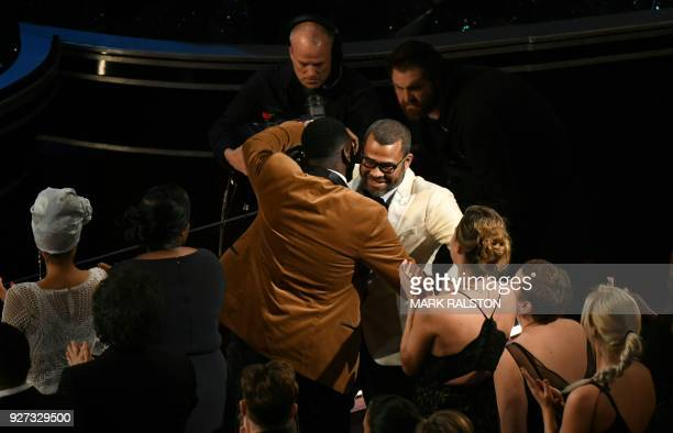 TOPSHOT Director Jordan Peele is congratulated by British actor Daniel Kaluuya after he won the Oscar for Best Original Screenplay for 'Get Out'...