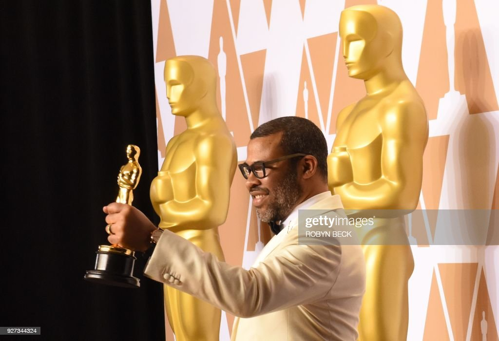 Director Jordan Peele poses in the press room with the Oscar for Best Original Screenplay for 'Get Out' during the 90th Annual Academy Awards on March 4, 2018, in Hollywood, California. / AFP PHOTO / Robyn Beck