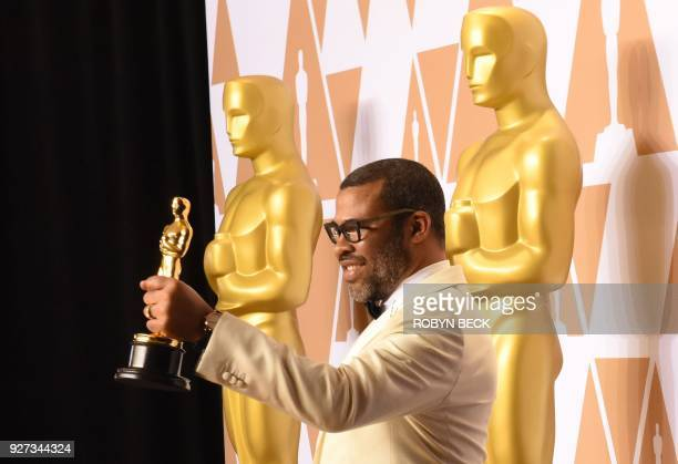 Director Jordan Peele poses in the press room with the Oscar for Best Original Screenplay for 'Get Out' during the 90th Annual Academy Awards on...