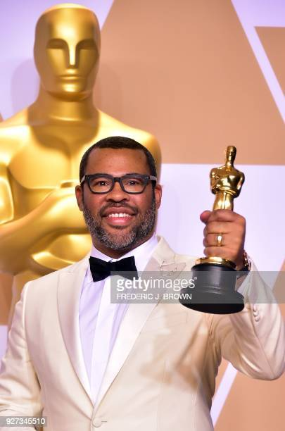 Director Jordan Peele poses in the press room with the Oscar for best original screenplay during the 90th Annual Academy Awards on March 4 in...