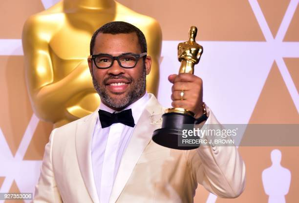 TOPSHOT Director Jordan Peele poses in the press room with the Oscar for best original screenplay during the 90th Annual Academy Awards on March 4 in...