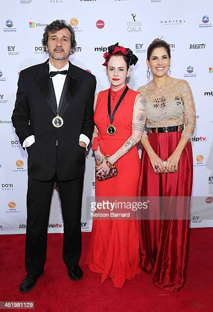 Director Jose Alvarenga writer Fernanda Young and guest attend the 41st International Emmy Awards at the Hilton New York on November 25 2013 in New...