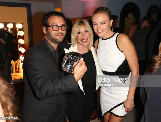 Director Josh Fox winner of the Documentary Film Award Environmental Media Association President Debbie Levin and actress Malin Akerman attend the...