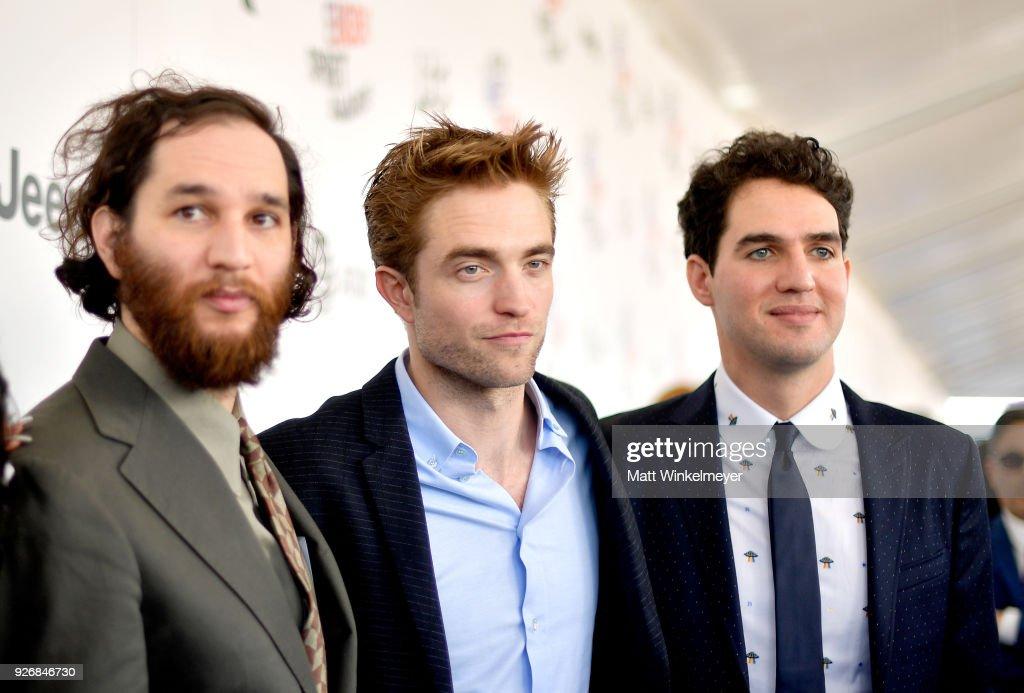 Director Josh Safdie, actor Robert Pattinson, and director Benny Safdie attend the 2018 Film Independent Spirit Awards on March 3, 2018 in Santa Monica, California.