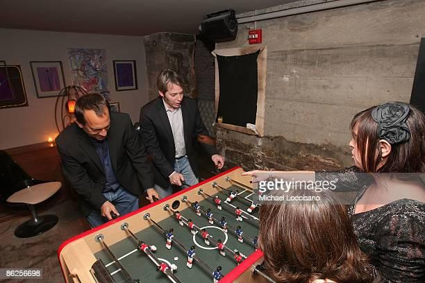 Director Joshua Goldin actor Matthew Broderick associate producer Amanda Marshall and producer Miranda Bailey play foosball during the after party...