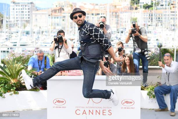 Director Jr attends the 'Faces Places ' photocall during the 70th annual Cannes Film Festival at Palais des Festivals on May 19 2017 in Cannes France