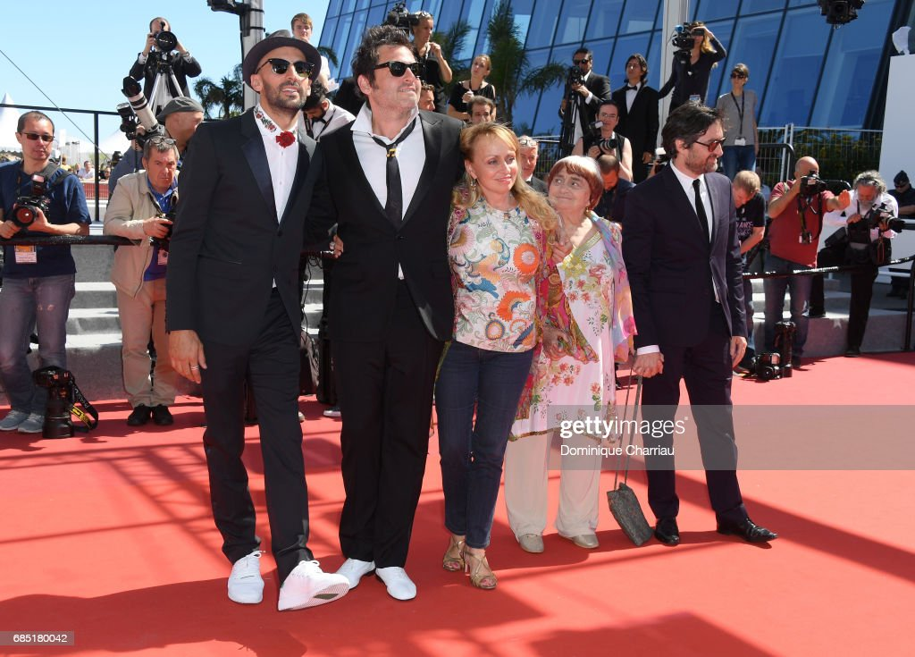Director JR, composer Matthieu Chedid, director Agnes Varda and members of the cast pose as they attend the 'Faces, Places (Visages, Villages)' screening during the 70th annual Cannes Film Festival at Palais des Festivals on May 19, 2017 in Cannes, France.