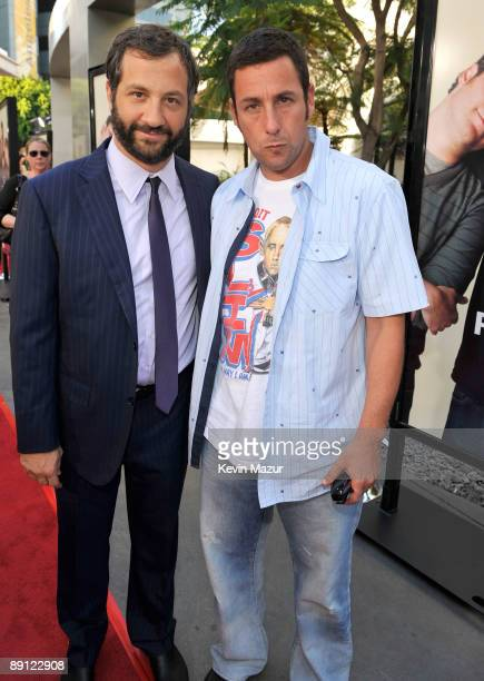 Director Judd Apatow and Actor/Executive Producer Adam Sandler arrive on the red carpet of the Los Angeles premiere of Funny People held at the...