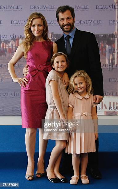 S director Judd Apatow poses with his wife actress Leslie Mann and their daughters Iris Maude at the photocall for the film Knocked upduring the 33rd...