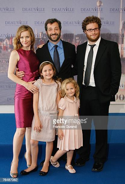 S director Judd Apatow poses with his wife actress Leslie Mann their daughters Iris Maude and actor Seth Rogen poses at the photocall for the film...