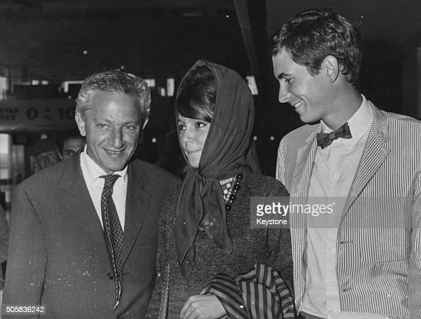 Director Jules Dassin with actors Elizabeth Ercy and Anthony Perkins as they arrive to film 'Phaedra' in Paris 1962