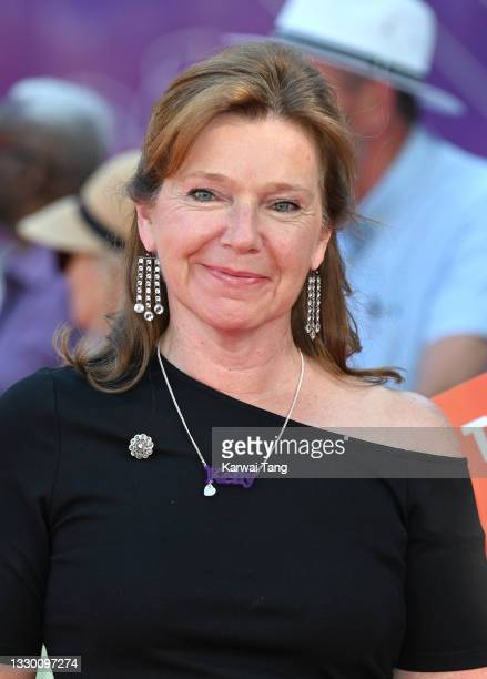 """Director Jules Williamson wears a necklace in tribute to actress Kelly Preston, who died of breast cancer in 2020, as she attends the """"Off The Rails""""..."""