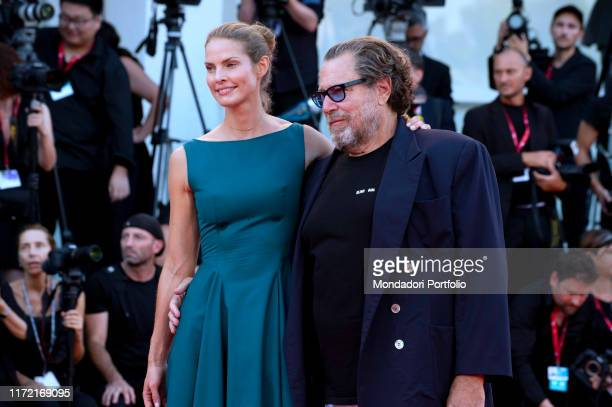 US director Julian Schnabel and his partner screenwriter Louise Kugelberg arrive for the screening of the film J'Accuse presented in competition on...