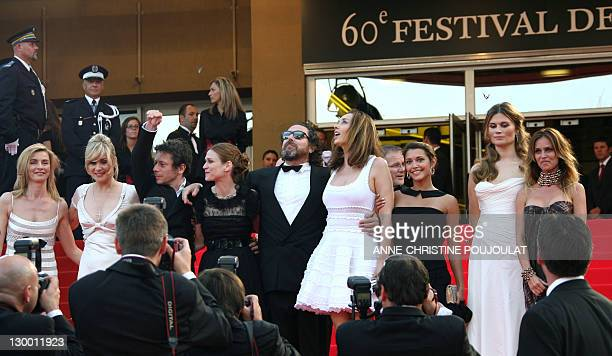 US director Julian Schnabel and his wife Spanish actress Olatz Lopez Garmendia look at butterflies 22 May 2007 flying in the sky as they pose with...