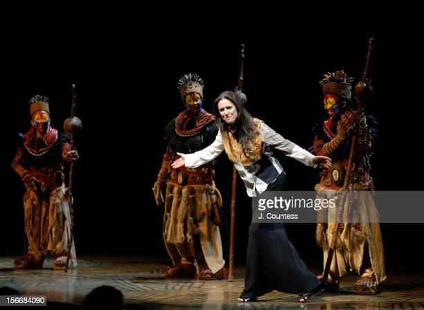 Director Julie Taymor joins the cast to take a bow during 'The Lion King' Broadway 15th Anniversary Celebration at Minskoff Theatre on November 18...