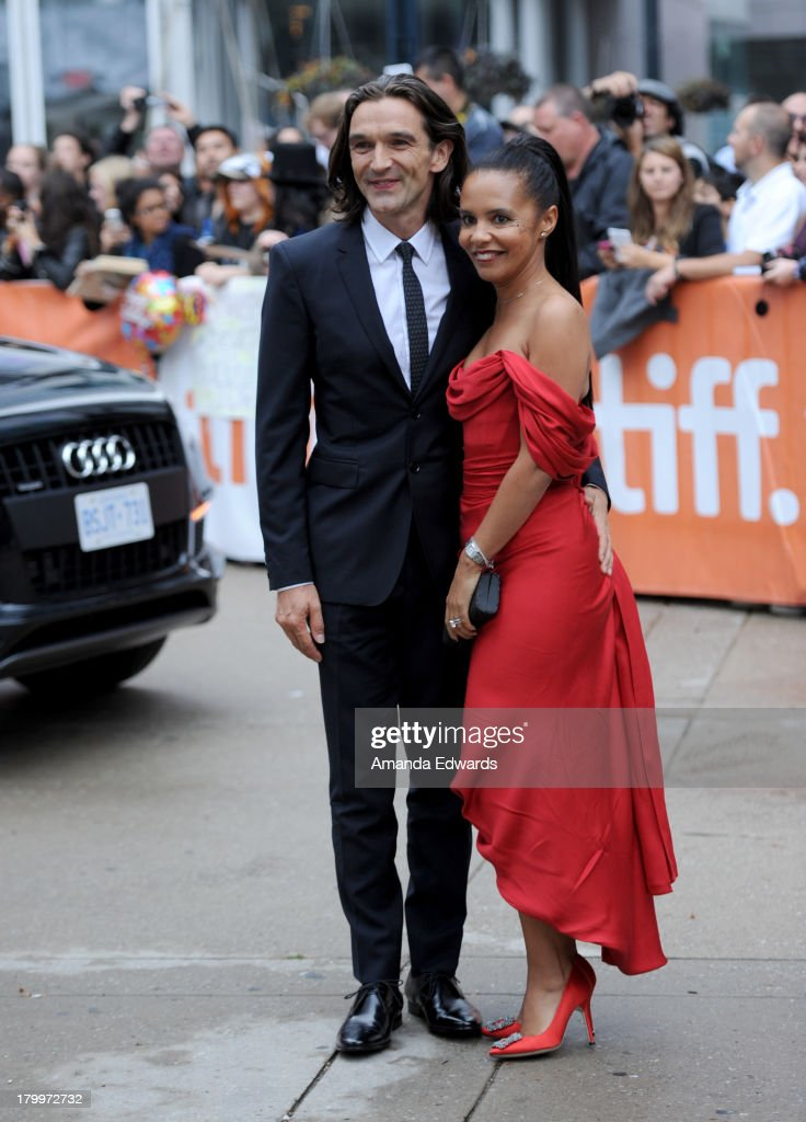 Director Justin Chadwick and guest attend the 'Mandela: Long Walk To Freedom' premiere during the 2013 Toronto International Film Festival at Roy Thomson Hall on September 7, 2013 in Toronto, Canada.