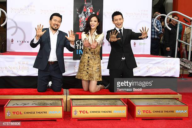 Director Justin Lin actors Zhao Wei and Huang Xiaoming are honored with hand/footprint ceremony during the 88th Birthday Commemoration Of TCL Chinese...