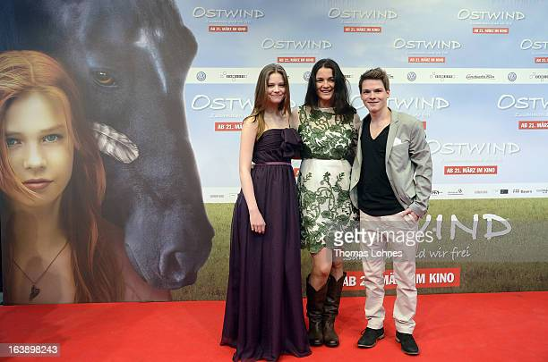 Director Katja von Garnier poses with Actress Hanna Binke and Actor Marvin Linke on the red carpet for the premiere of the film Ostwind on March 17...