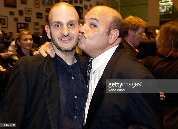 Director Keith Gordon and actor Jon Polito attend a party after the premiere of the film The Singing Detective during the Hollywood Film Festival on...