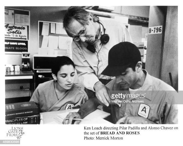 Director Ken Loach and actress Pilar Padilla and actor Alonso Chavez on set of the movie 'Bread and Roses' circa 2000
