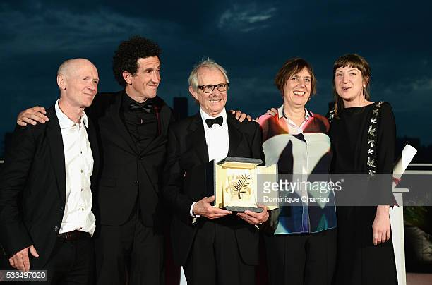 Director Ken Loach poses with The Palme d'Or for the movie 'IDaniel Blake' next to British screenwriter Paul Laverty cinematographer Robbie Ryan and...