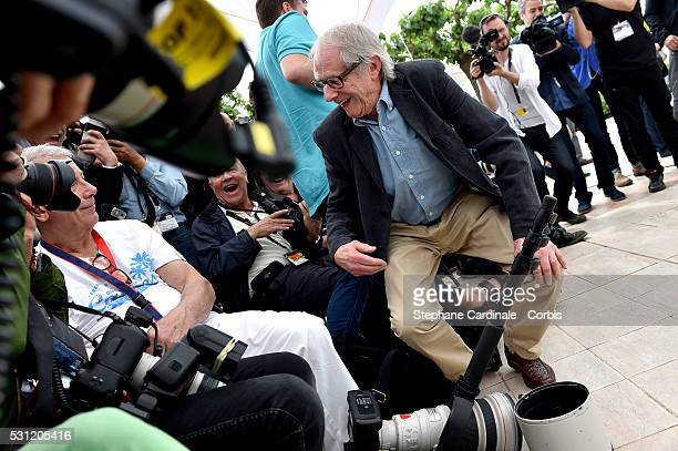 Director Ken Loach speaks with a photographer during the I Daniel Black photocall during the 69th annual Cannes Film Festival at the Palais des...