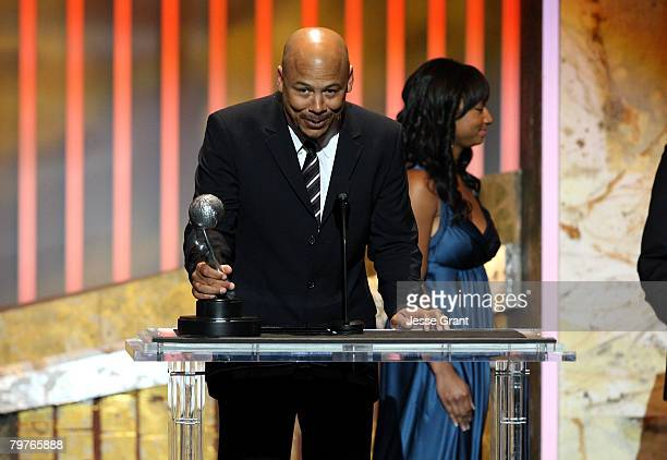 Director Ken Whittingham accepts the Outstanding Directoring in a Comedy Series award for The Office Phyllis's Wedding as actress Monique Coleman...