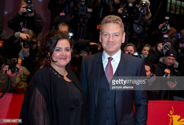 Director Kenneth Branagh and Lindsay Brunnock attend the premiere of Cinderella during the 65th International Berlin Film Festival Berlinale at...