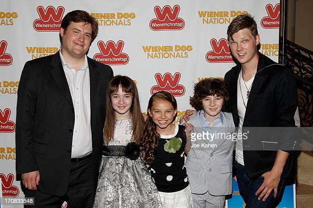 Director Kevan Peterson actors Madison Mier Caitlin Carmichael Julian Feder and Austin Anderson attend the Wiener Dog NationalsGreen GrassCarpet Film...