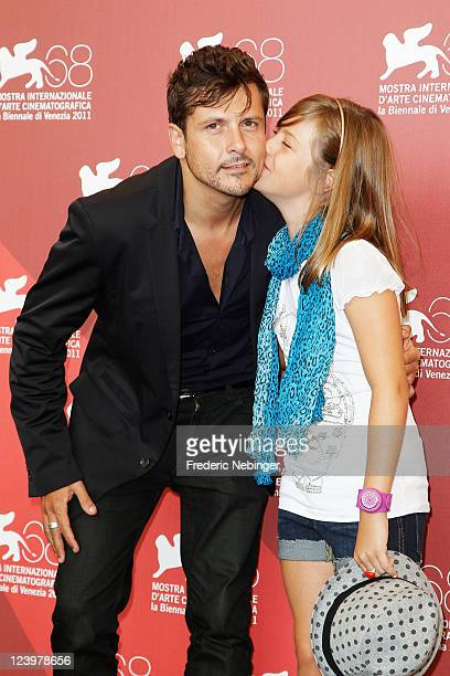 Director Kike Maillo and actress Claudia Vega pose at the Eva photocall during the 68th Venice Film Festival at Palazzo del Cinema on September 7...