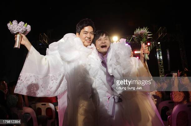 Director Kim Jho Kwang Soo and Kim SeungHwan walk down the aisle after being married as the first samesex couple to get married in South Korea at the...