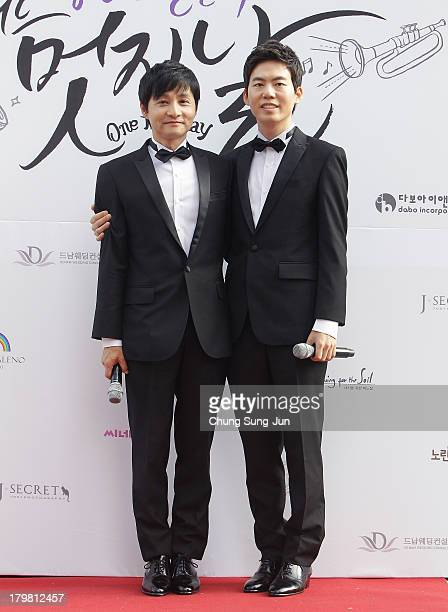 Director Kim Jho KwangSoo and Kim SeungHwan pose before their wedding as the first samesex couple to get married in South Korea at the Cheonggyecheon...