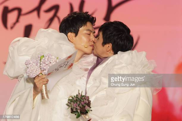 Director Kim Jho KwangSoo kisses his partner Kim SeungHwan during their wedding as the first samesex couple to get married in South Korea at the...