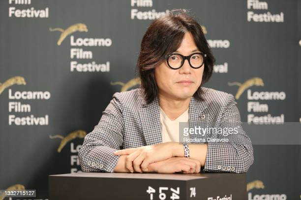Director Kim Ji-Hoon attends a photocall during 74th Locarno Film Festival on August 06, 2021 in Locarno, Switzerland.