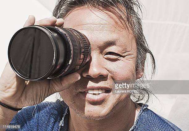 Director Kim KiDuk portrait session Director of the Arirang film he obtains the award Un Certain Regard during the 64th Annual Cannes Film Festival...