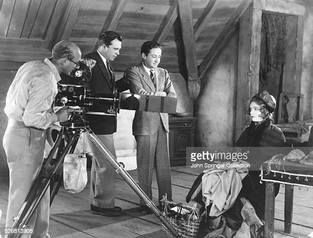 Director King Vidor and Producer Irving Thalberg stand by as a cameraman films Actress Lillian Gish