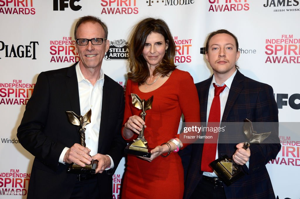 Director Kirby Dick and producers Amy Ziering and Tanner King Barklow pose with the Best Documentary award for 'The Invisible War' in the press room during the 2013 Film Independent Spirit Awards at Santa Monica Beach on February 23, 2013 in Santa Monica, California.