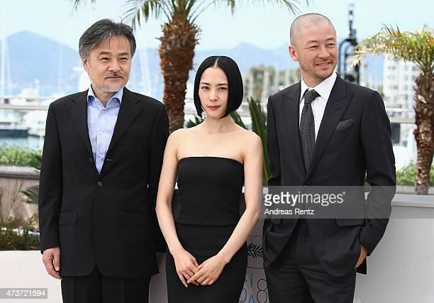 Director Kiyoshi Kurosawa and actors Eri Fukatsu and Tadanobu Asano attend the 'Kishibe No Tabi' Photocall during the 68th annual Cannes Film...