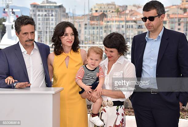 Director Kleber Mendonca Filho producer Emilie Lesclaux actress Amanda Gabriel and producer Said Ben Said attend the Aquarius photocall during the...