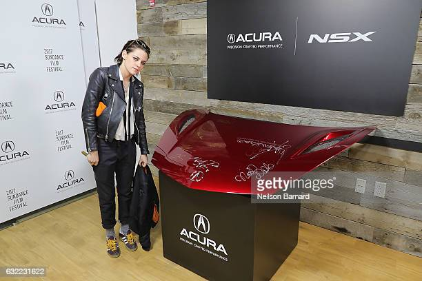 Director Kristen Stewart of 'Come Swim' signs the hood of a 2017 Acura NSX at the Acura Studio during Sundance Film Festival 2017 in Park City on...