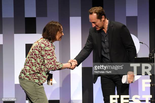 Director Kristin Ulseth accepts the award for Best Animated Short from Juror Brennan Brown during Awards Night during the 2017 Tribeca Film Festival...