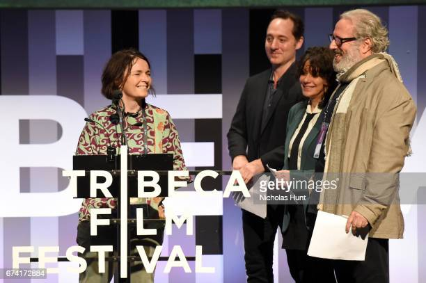 Director Kristin Ulseth accepts the award for Best Animated Short from Jurors Brennan Brown Amy Heckerling and Udi Aloni during Awards Night during...