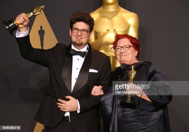 Director Kristof Deak and producer Anna Udvardy, winners of Best Live Action Short Film for 'Sing' pose in the press room at the 89th Annual Academy...