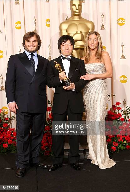 Director Kunio Kato poses in the press room with his Best Short Film award for La Maison en Petits Cubes and presenters Jack Black and Jennifer...