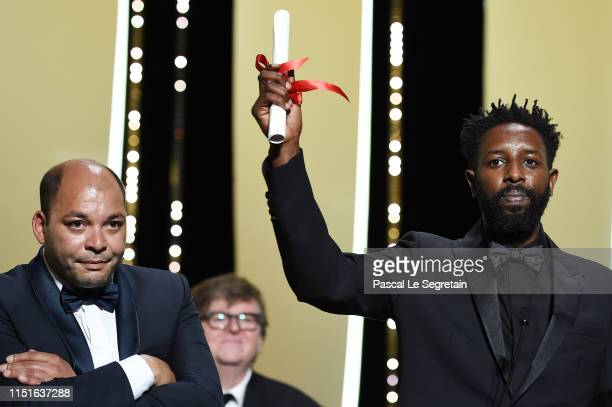 Director Ladj Ly and Toufik Ayadi receive the Jury Prize for their film Les Miserables at the Closing Ceremony during the 72nd annual Cannes Film...