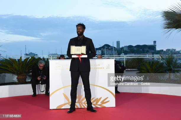Director Ladj Ly winner of the Jury Price award for his film Les Miserables poses at the photocall for Palme D'Or Winner during the 72nd annual...