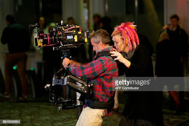 US director Lana Wachowski checks a steadycam's monitor on the set of Netflix TV scifi series Sense8 in the Montmartre area of Paris on october 21...