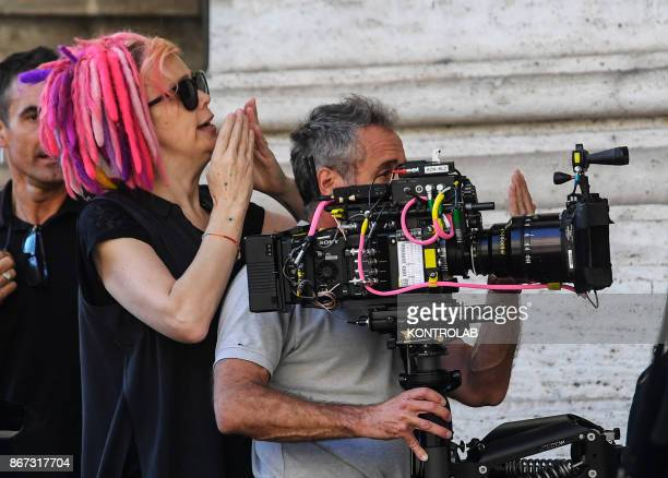 US director Lana Wachowski checks a steadycam's on the set of Netflix TV scifi series 'Sense8' in the Station in Naples