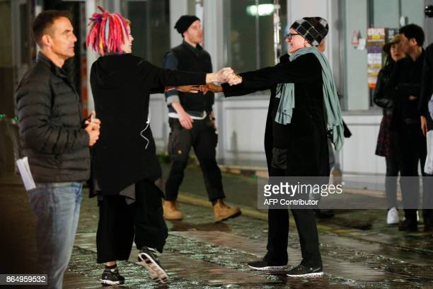 US director Lana Wachowski dances with her girlfriend Karin Winslow on the set of Netflix TV scifi series Sense8 in the Montmartre area of Paris on...
