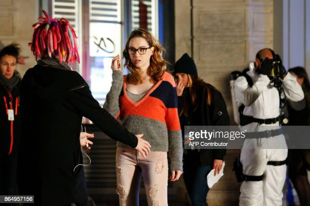 US director Lana Wachowski talks with US actress Jamie Clayton on the set of Netflix TV scifi series Sense8 in the Montmartre area of Paris on...